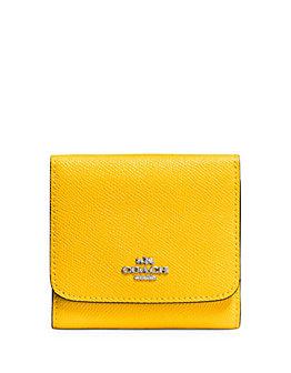 COACH Crossgrain 黄色小号折叠钱包 69加元,原价 115加元