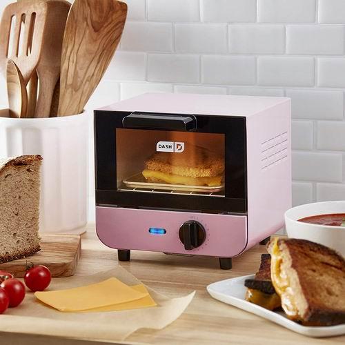 DASH DMTO100GBPK04 粉色迷你烤箱 54.41加元,原价 79.19加元,包邮